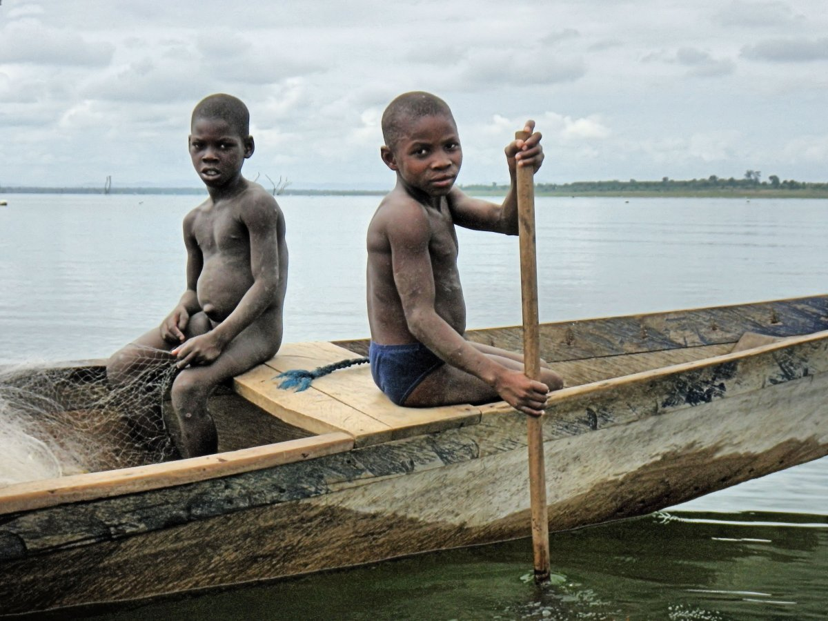 Children photographed fishing on Lake Volta, Ghana, in 2013 Source: IJM