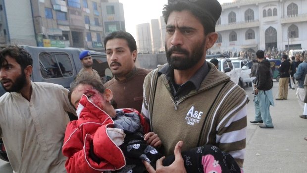 A girl injured in the Taliban attack is rushed to a hospital in Peshawar. (Mohammad Sajjad/Associated Press). Source: www.cbc.ca
