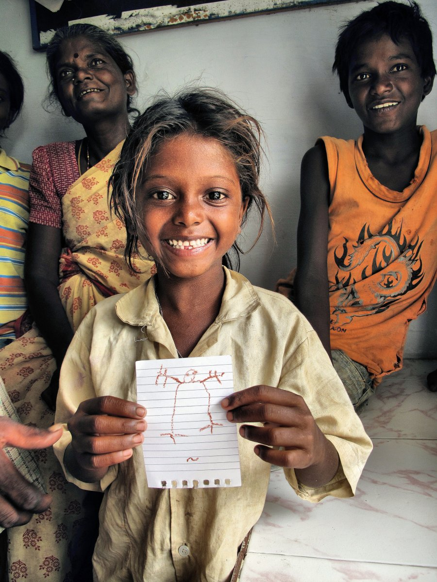 Jayanthi, pictured on the same day she was rescued from slavery in the rock quarry. She received an official release certificate declaring her free, and the picture she holds was the first drawing she had ever made.