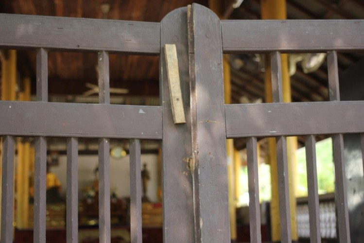 The closed gates of one of the primary worship areas in a temple where the boys were abused. Most of the temples where boys were abused in this case have been abandoned since the convictions.