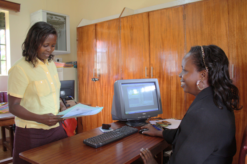 Mukono Chief Magistrate's Court staff assisting client using newly installed case management system.