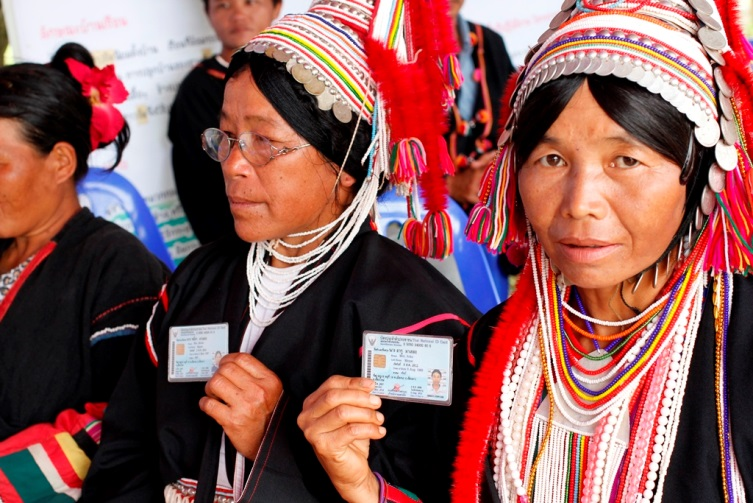 Women from the Akha hill tribe hold their Thai citizenship cards.